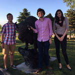 Students James Smith '19, Elliot Schwartz '19, and Jordan Kobbervig '19 standing beside a bison statue.