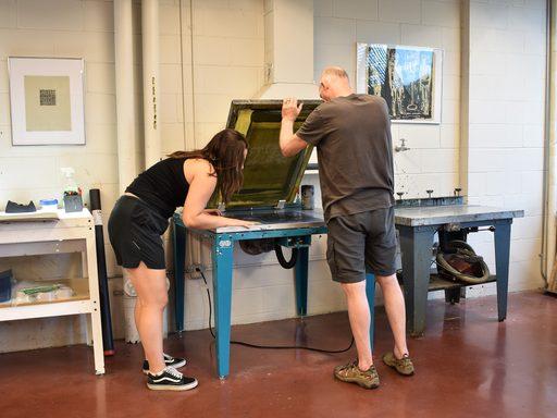 Grant recipient Fred Hagstrom and SRA Justine Szafran ('19) printmaking