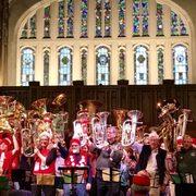 Dozens of tuba players gather in Skinner Chapel for Tuba Christmas