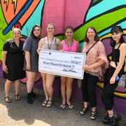 Carleton presents a check for $13,400 to the Northfield Union of Youth