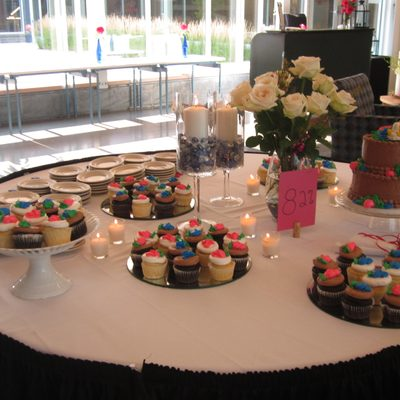 desserts and flowers on a table in the Weitz Center