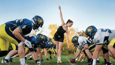 Carolyn Friedhoff performs ballet between the lines during a football scrimmage