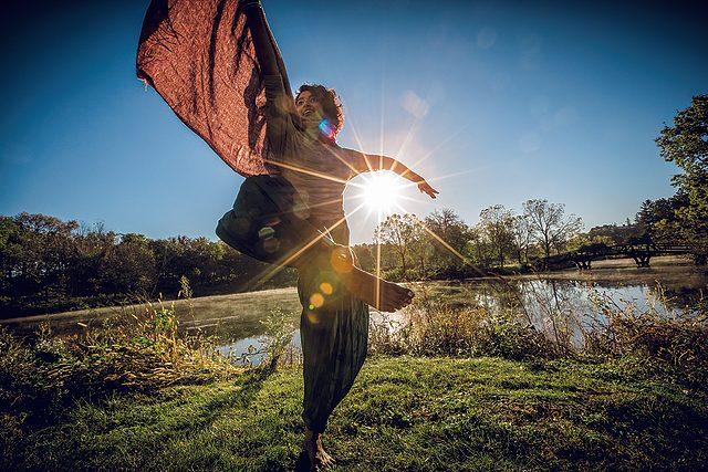 Ann Treesa Joy twirls barefoot in the grass on Stewsie Island