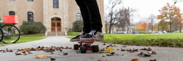 A student skateboards to class