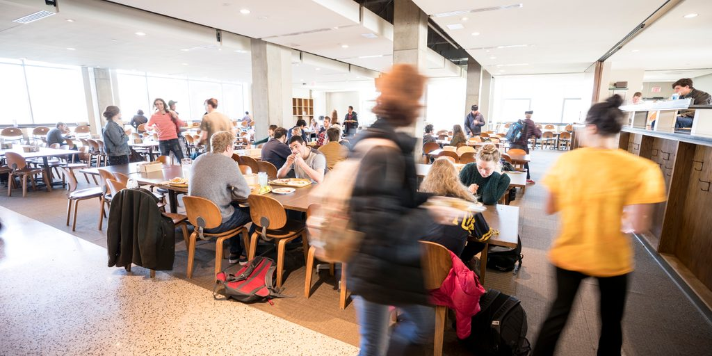 Students eat in a busy dining hall