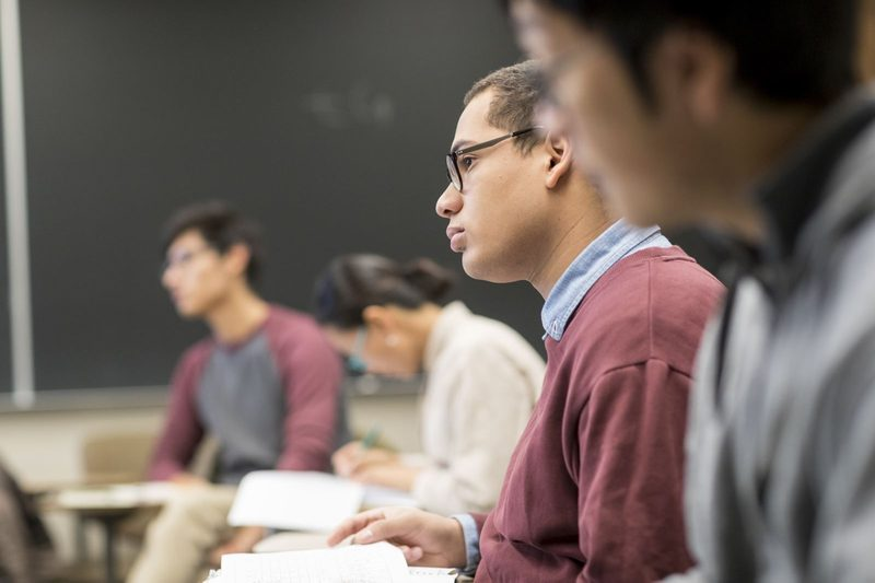 Students sit attentively in class