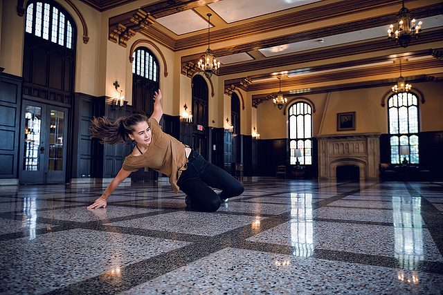 Elise Erickson slides across the polished terrazzo floor of Great Space