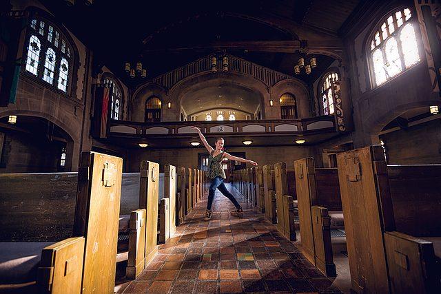 Ellis Johnston dances in the aisle between the Chapel pews