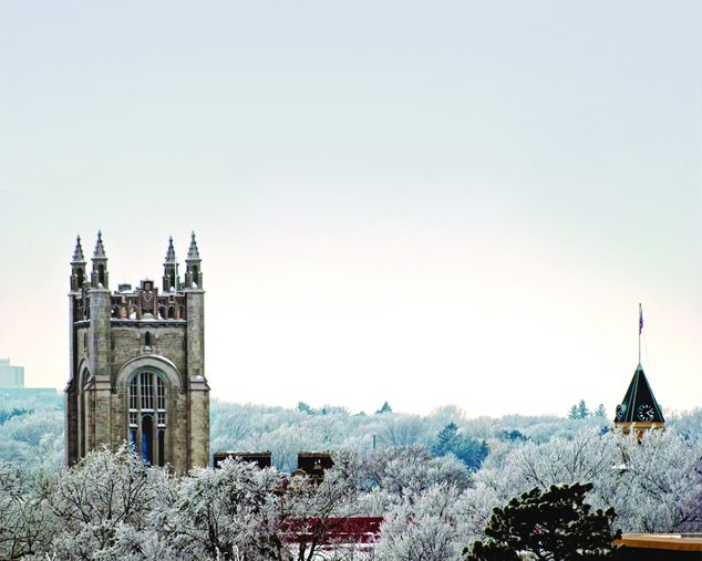 A view of the snowy skyline of campus, including the chapel