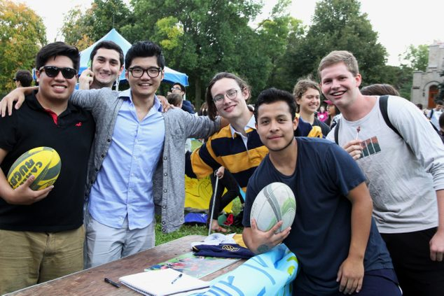 Rugby players pose at the student activities fair