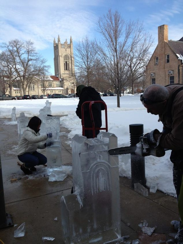 Students prepare ice sculptures using saws and chisels