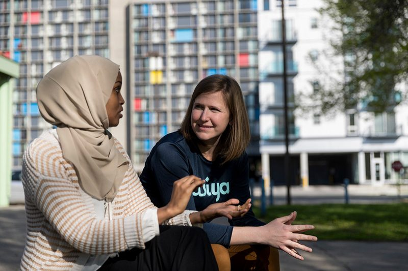 Jamie Glover '06 and Fatimah Hussein discuss a point in a city park