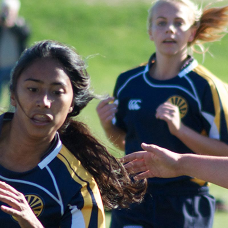 A student navigates the rugby pitch