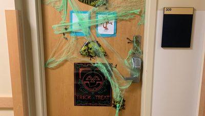 a dorm door with halloween decorations
