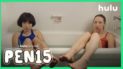 two women sitting in a bathtub with their legs hanging out