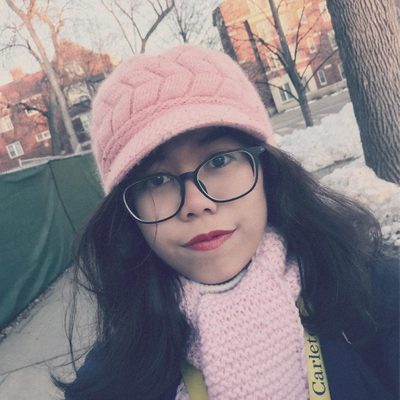 Chi Nguyen wearing a pink hat and scarf