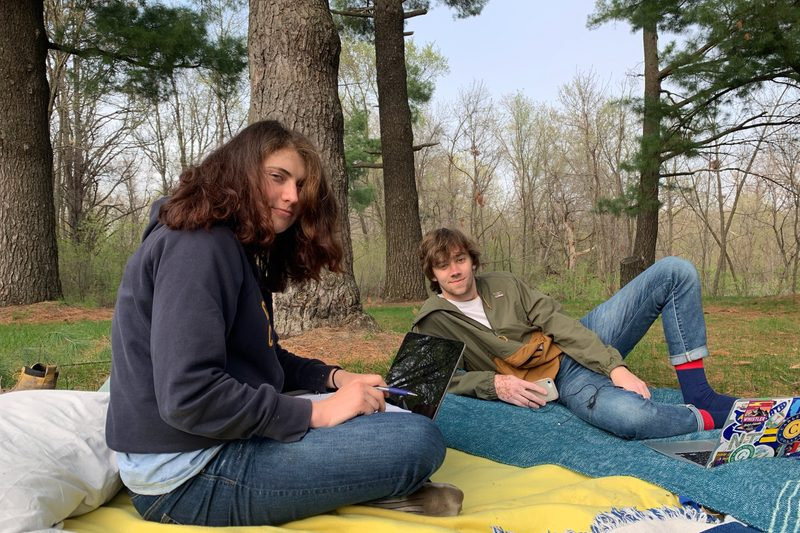 A picture of Lucas' friends Sonya and Jack on blankets in the arb