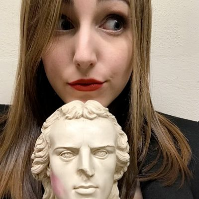 Alexandra Pozniak holds a tiny bust of Friedrich Schiller