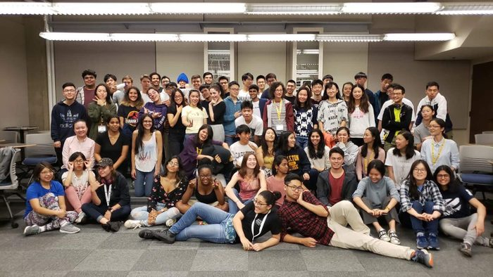 group of students posing for photo in a room