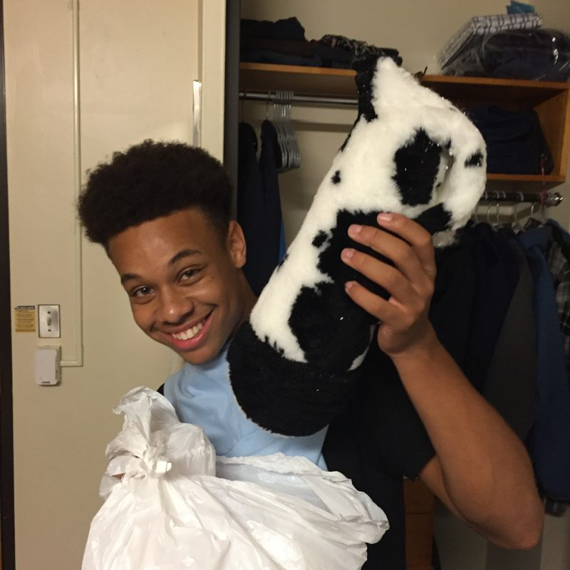 Indoor, happy young adult holding a stuffed cow leg