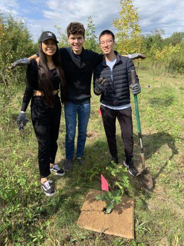 Friends celebrate planting trees in the arboretum.