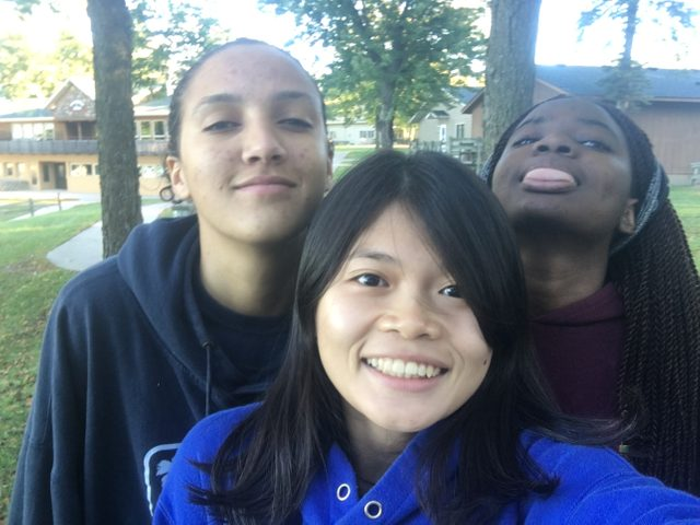 Three girls taking a photo