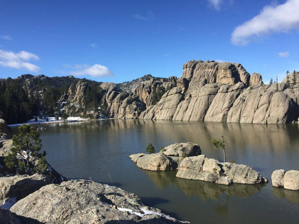 boulders on a blue lake