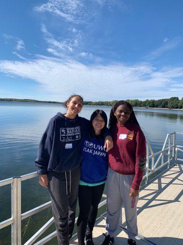 three girls by the lake