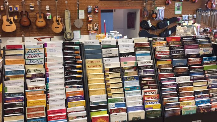 A shelf of sheet music in a music store