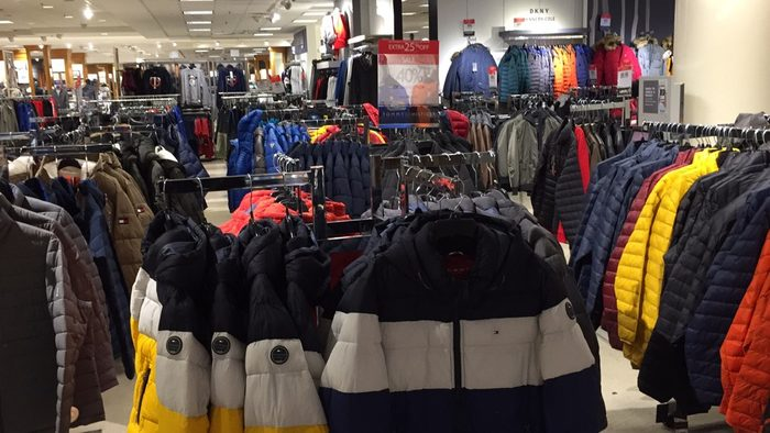 Rows of winter jackets in a store