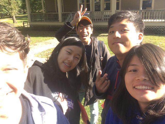 5 people taking a selfie