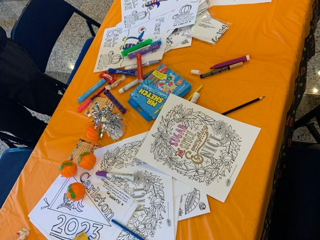 Coloring pages on table.