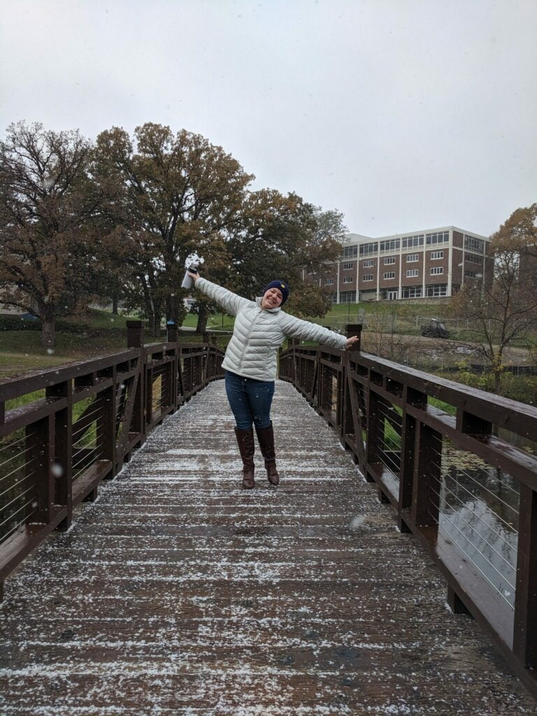 girl on bridge in snow