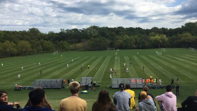 Outdoor, cloudy day, a women's soccer game in progress