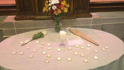 A white table with flowers and candles