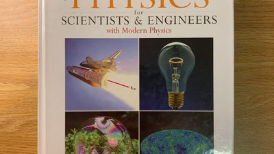 Physics for Scientists & Engineers by Giancoli on a desk.