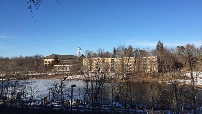A college dorm across a half frozen river