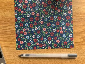 origami paper and pen
