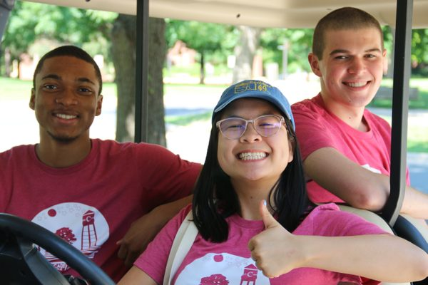 Program and Community Assistants on a golf cart