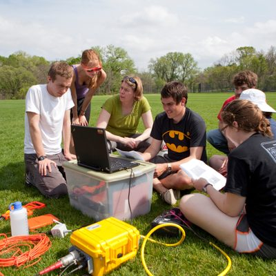 A Geology class performing fieldwork
