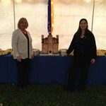 Cake replica of Willis Hall with General Manager, Katie McKenna, and Board Manager, Jenny Pope