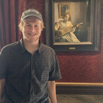 2019 David C. Donelson Fellowship recipient Hugo Caplow with a painting by Johannes Vermeer