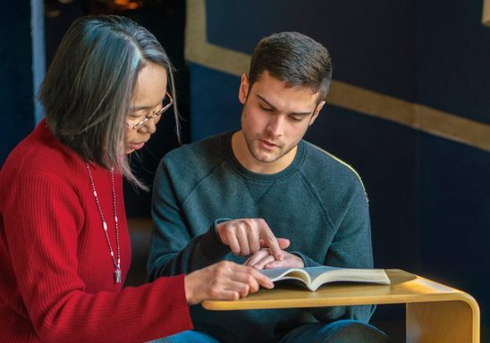 A professor and a student review a reading together