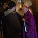 Archbishop Flynn greets students after Mass.