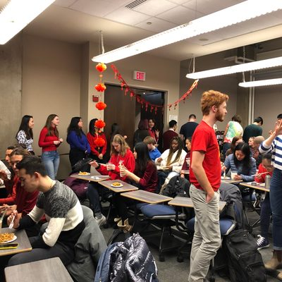 Students enjoying Chinese food at the Chinese Spring Festival.