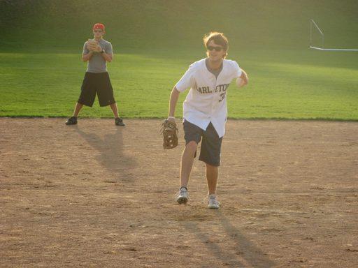John H pitching the softball.