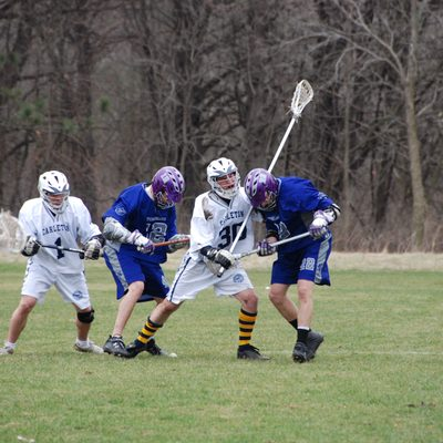 Members of club lacrosse playing in a game