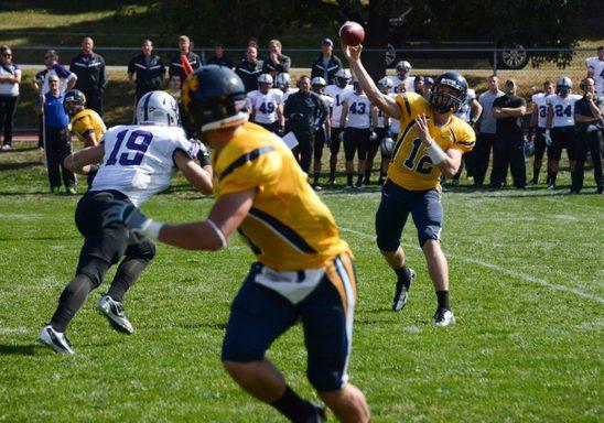 varsity football player prepares to recieve a catch