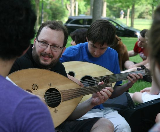 Prof. Yaron Klein and students playing oud at the MIddle East Languages picnic