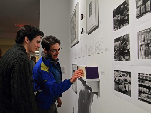Students at an art exhibition